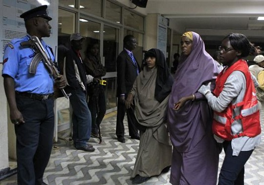 A Somali woman injured in a blast is assisted upon her arrival at Kenyatta National Hospital in Nairobi