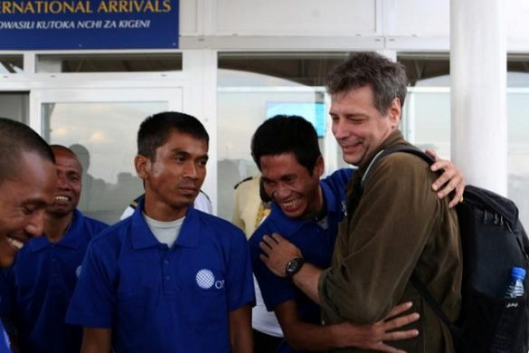 Some of the 26 Asian sailors released after being held captive by Somalia pirates for more than four years become emotional as they greet Michael Scott Moore (R), a former hostage who said that he was involved in helping with their release, as they arrive at the Jomo Kenyatta International airport in the capital Nairobi, Kenya, October 23, 2016. REUTERS/Siegfried Modola